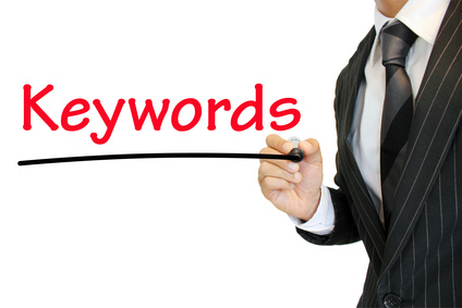 Business man emphasizing Keywords