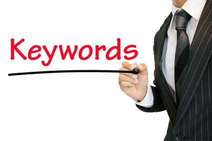Business man emphasizing Keywords